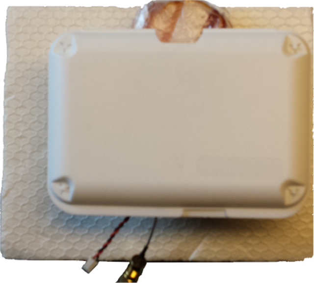 GPS chip loop antenna inside enclosure on bacon
